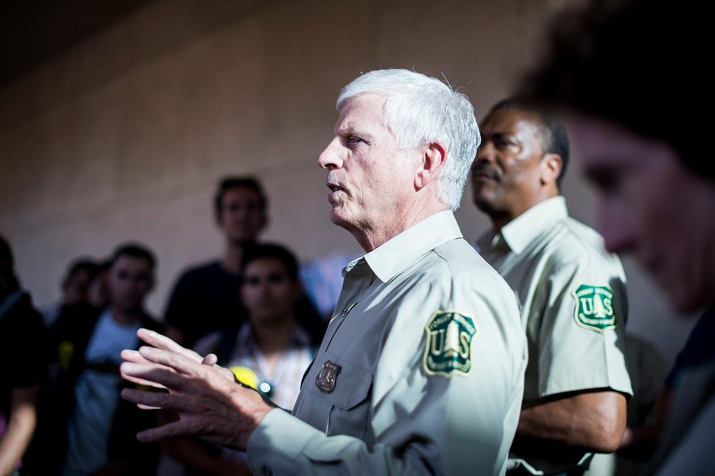Description of . U.S. Forest Service Chief Thomas Tidwell speaks to an overflow crowd outside a San Gabriel Mountains meeting Tuesday night, August 26, 2014 at Baldwin Park Performing Arts Center. Rep. Judy Chu has a bill to make the area a national recreation area but has since asked President Obama to make the mountains a national monument. (Photo by Sarah Reingewirtz/Pasadena Star-News)