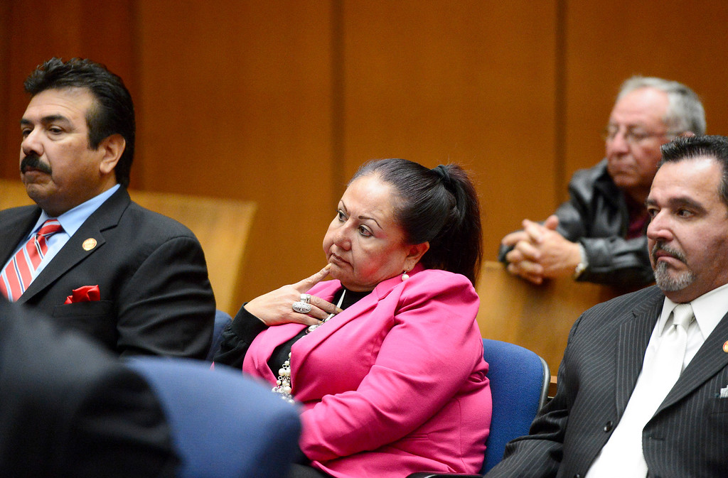 Description of . Irwindale officials, from left, Councilman Manuel Garcia, former Councilwoman Rosemary Ramirez and Mayor Mark Breceda along with Abe De Dios, retired finance director, not seen, appear in court for the fifth time Tuesday, December 17, 2013 at Clara Shortridge Foltz Criminal Justice Center in Los Angeles as attorneys argue statue of limitations on conflict of interest and misappropriation of public funds' charges. Javier Robles, behind, watches the proceedings. (Photo by Sarah Reingewirtz/Pasadena Star-News)