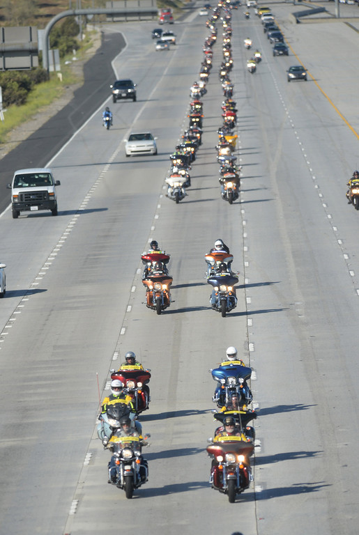 Description of . Run For The Wall motorcycle riders pass through Fontana, Ca., on Interstate 15, heading to the Vietnam Memorial Wall in Washington D.C., Wednesday, May 14, 2014. Hundreds of