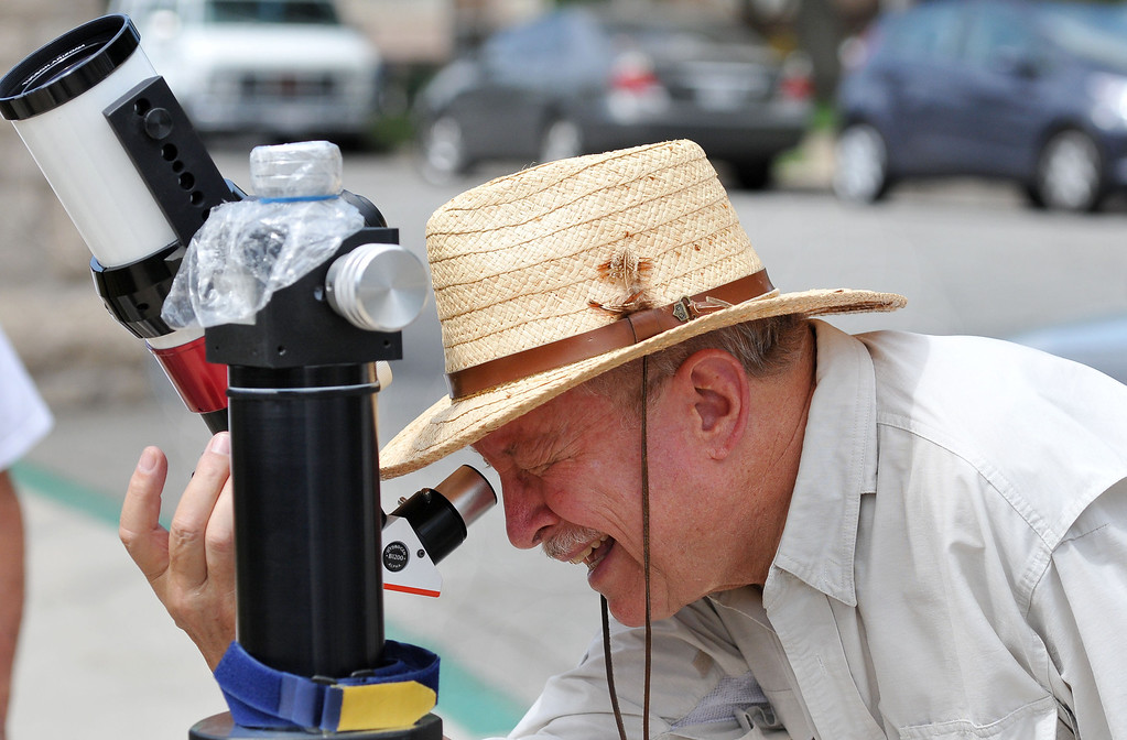 "Description of . (John Valenzuela/Staff Photographer) Jim Sommer, a member of the San Bernardino Valley Amateur Astronomers, brought his Lunt 60MM Solar Telescope to the the A.K. Smiley Library  to let people ""safely"" view the sun, in Redlands Thursday, August 29, 2013."