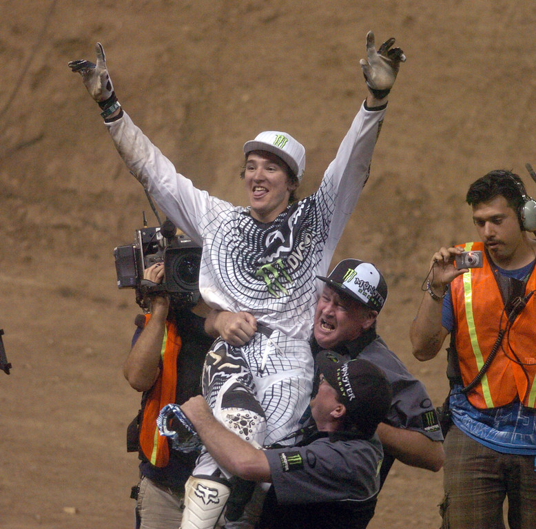 Description of . Blake Williams celebrates his win in the MOTO X Freestyle during the ESPN X Games at the Home Depot Center in Carson on Saturday August 1, 2009. Blake Williams wins the Gold Medal. (SGVN/Staff Photo by Keith Durflinger/SPORTS)