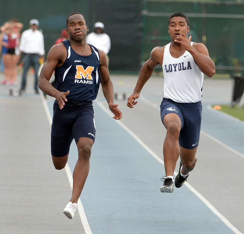 Description of . Millikan's Malik Brown, left, along with Loyola's Nico Evans competes in the division 1 100 meter dash during the CIF Southern Section track and final Championships at Cerritos College in Norwalk, Calif., Saturday, May 24, 2014. 