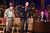 Host Jay Leno, right, watches Anthony Hopkins, left, and comedian Howie Mandel dance during the taping of