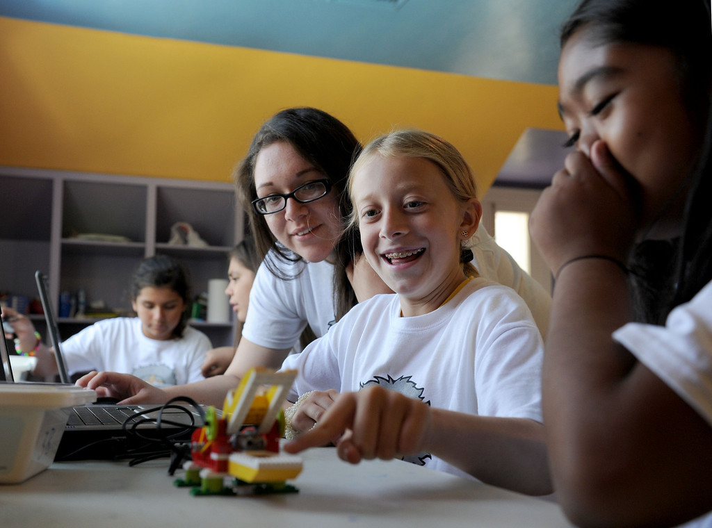 Description of . (John Valenzuela/Staff Photographer) Camp counselor Daysi Mata watches over Gillian Long, 10, and Krystn Hall, 11, while they computer software to animate their robotic lego alligator, during The Boys and Girls Club's of Redlands' Camp Einstein Camp, Thursday's at the Burrage Mansion in Redlands, Aug. 2, 2013.