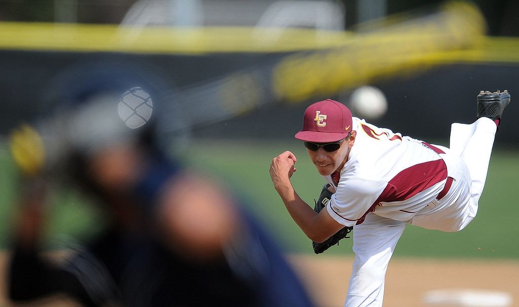 Description of . La Canada starting pitcher Justin Lewis throws to California's Jesse Oropeza (C) in the second inning of a CIF-SS playoff baseball game at La Canada High School on Thursday, May 16, 2013 in La Canada, Calif. La Canada won 4-2.  (Keith Birmingham Pasadena Star-News)
