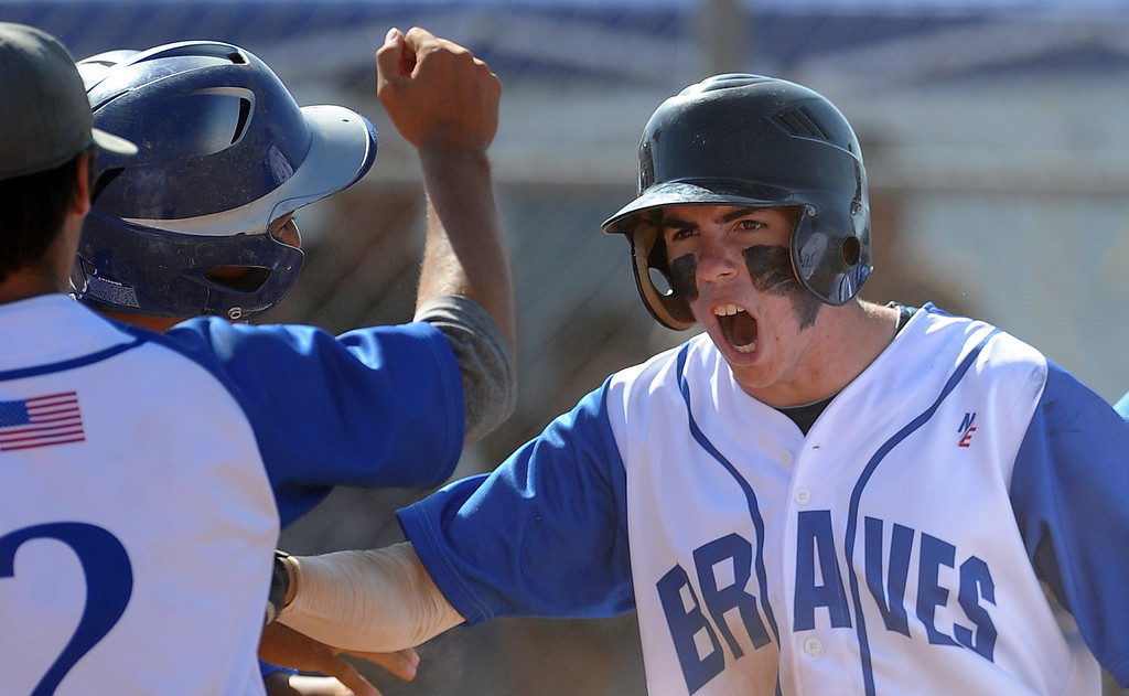 Description of . Baldwin Park's Ryan Cruz (C) reacts after hitting a three run home run in the fifth inning of a CIF-SS semifinal prep playoff baseball game against El Rancho at Baldwin Park High School on Tuesday, May 28, 2013 in Baldwin Park, Calif.  El Rancho won 5-4.  (Keith Birmingham/Pasadena Star-News)