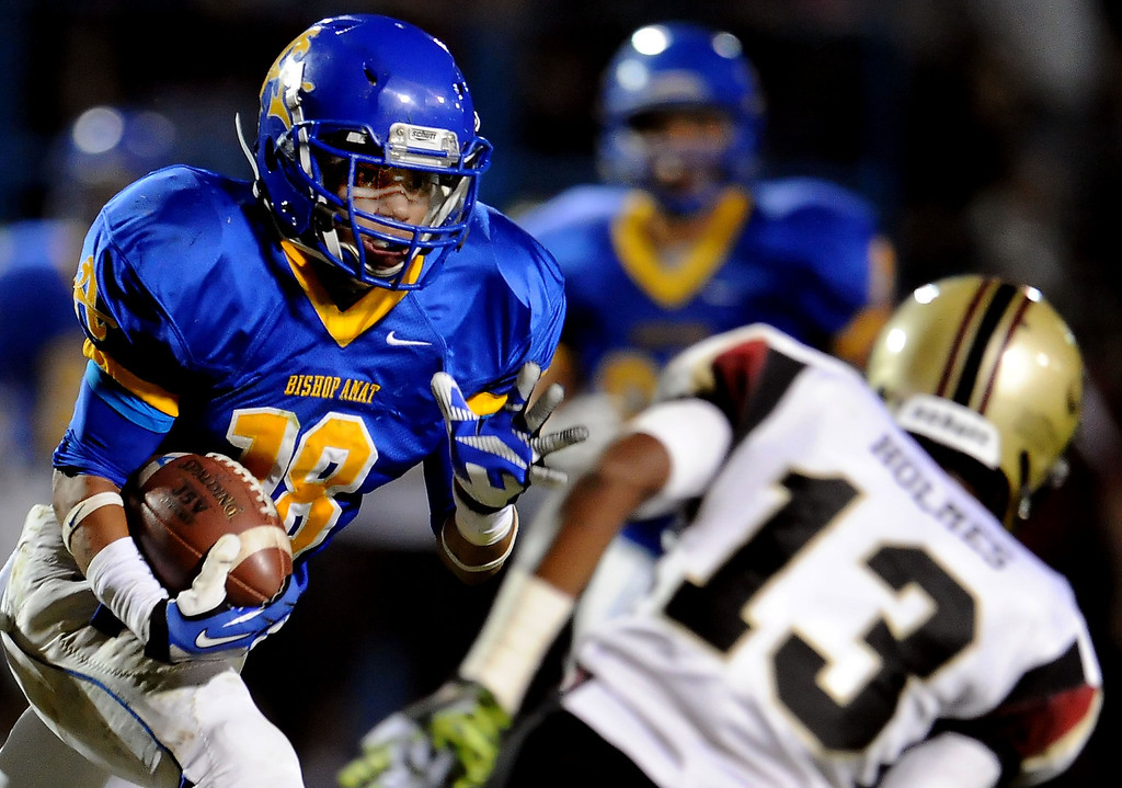 Description of . Bishop Amat's Trevon Sidney catches a pass for a touchdown past Alemany's Desean Holmes (13) in the first half of a prep football game at Bishop Amat High School in La Puente, Calif., on Friday, Oct. 25, 2013.    (Keith Birmingham Pasadena Star-News)