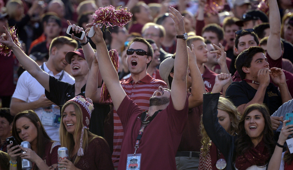 Description of . Florida State fans react in the first half of the BCS National Championship game against Auburn at the Rose Bowl in Pasadena, Calif., on Monday, Jan. 6, 2014. 