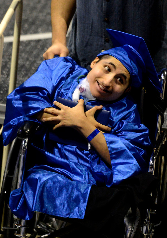Description of . Christian Butanda, 19, of Rialto, reacts after receiving his diploma during Rialto High School Commencement Exercises held at Citizens Bank Arena in Ontario June 2, 2013. GABRIEL LUIS ACOSTA/STAFF PHOTOGRAPHER.