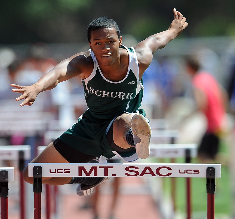 Description of . Schurr's Dario Robinson in the 100 meter high hurdles during the CIF-SS track & Field championship finals in Hilmer Stadium on the campus of Mt. San Antonio College on Saturday, May 18, 2013 in Walnut, Calif.  (Keith Birmingham Pasadena Star-News)