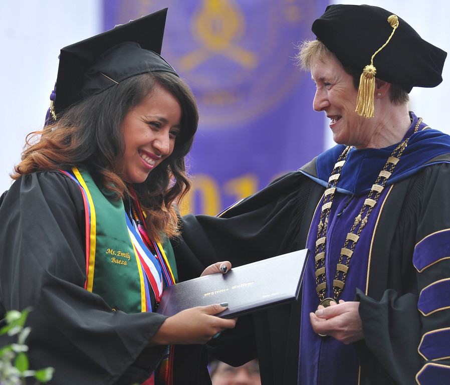 Description of . Senior speaker, Emily Baeza, receives her diploma from President Sharon Herzberger during the 110th Commencement Ceremony at Memorial Stadium on the Whittier College campus in Whittier on Friday May 17, 2013. Award-winning journalist Sonia Nazario gave the keynote address and received an honorary degree from the Whittier College faculty: a doctorate of humane letters.(SGVN/Staff Photo by Keith Durflinger)