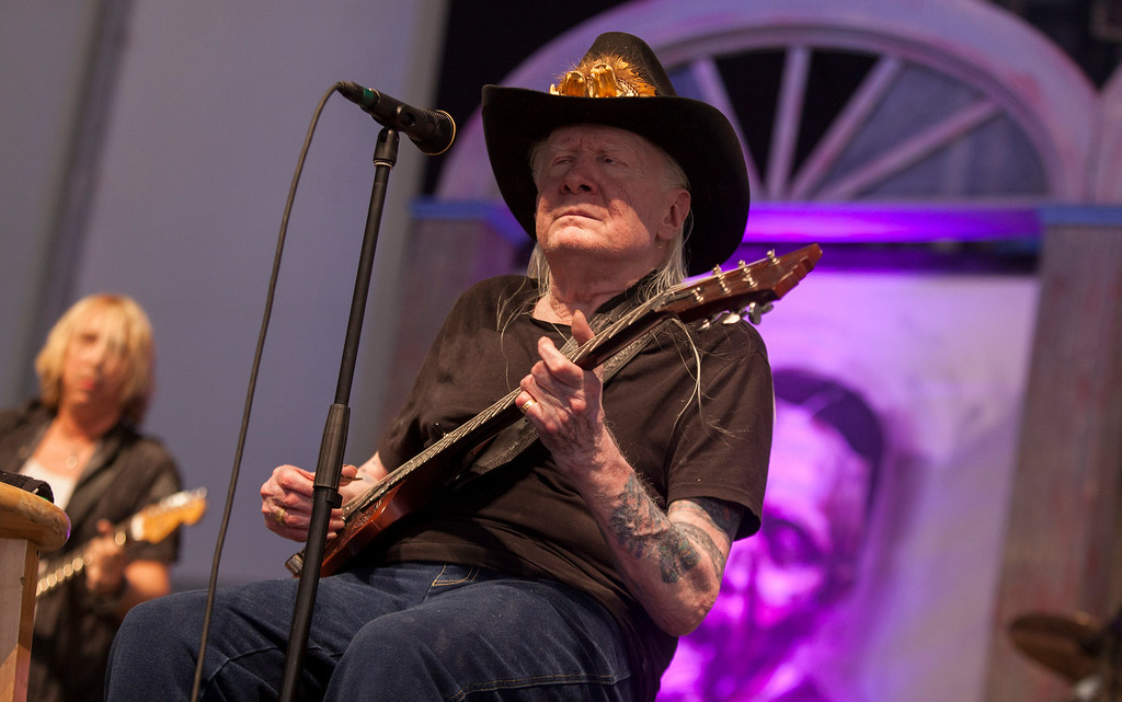 Description of . Johnny Winter performs at the New Orleans Jazz and Heritage Festival in New Orleans on Saturday, May 3, 2014. Winter died on July 16, 2014. He was 70. Leave a message to remember Winter: http://bit.ly/1mK1aZG  (Photo by Barry Brecheisen/Invision/AP)