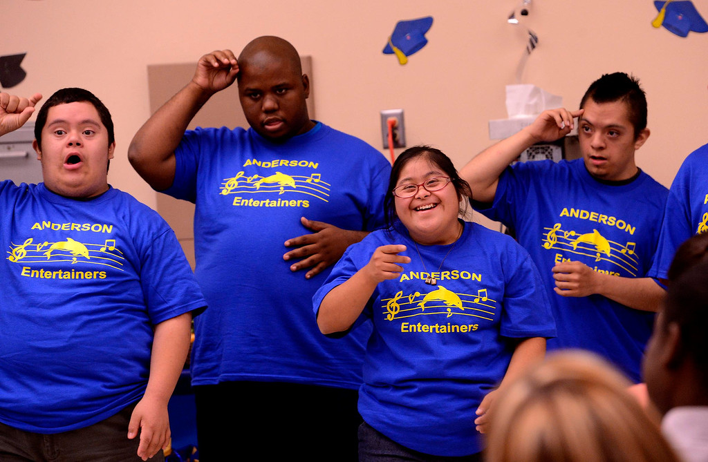 Description of . Daisy Pineda, second from right, performs with the Anderson Entertainers during Commencement Ceremonies at Carl And Dora Anderson School in San Bernardino May 21, 2013.  Seventeen developmentally disabled students graduated from the school.  GABRIEL LUIS ACOSTA/STAFF PHOTOGRAPHER.