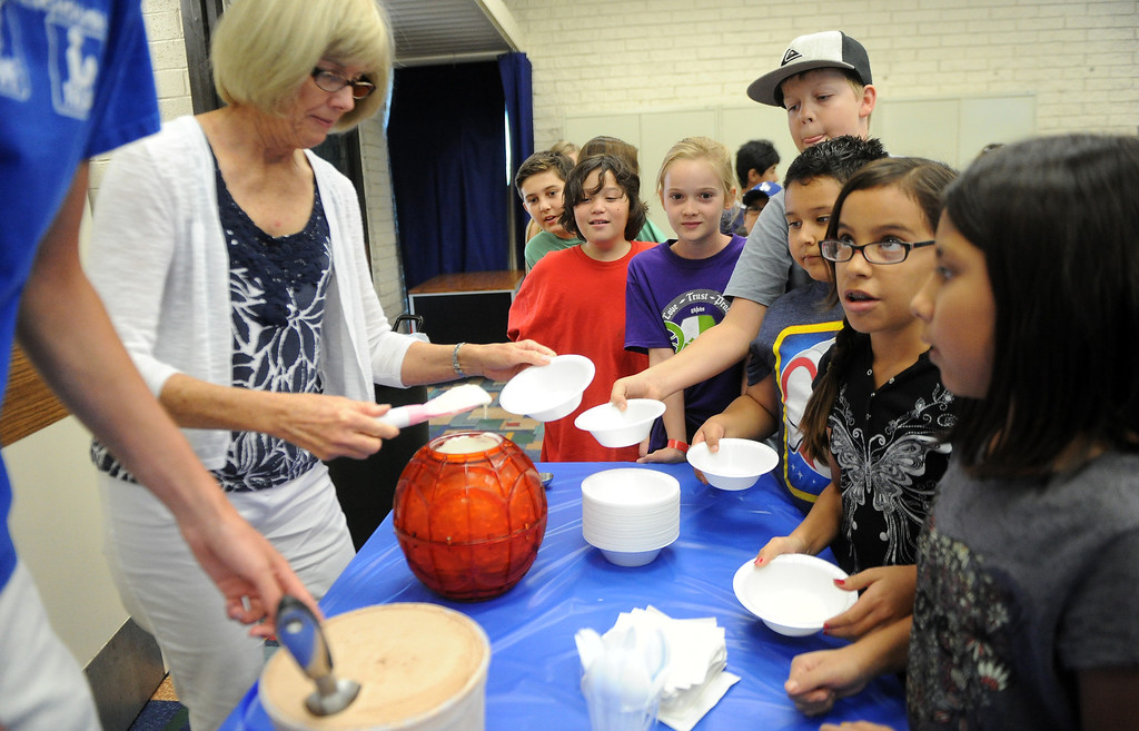 Description of . Sherry Heinrich, left, serves-up ice cream during a Summer Teen Reading Club ice-cream making and tasting session at the Glendora Public Library Bidwell Forum on Wednesday, July 17, 2013 in Glendora, Calif.   (Keith Birmingham/Pasadena Star-News)
