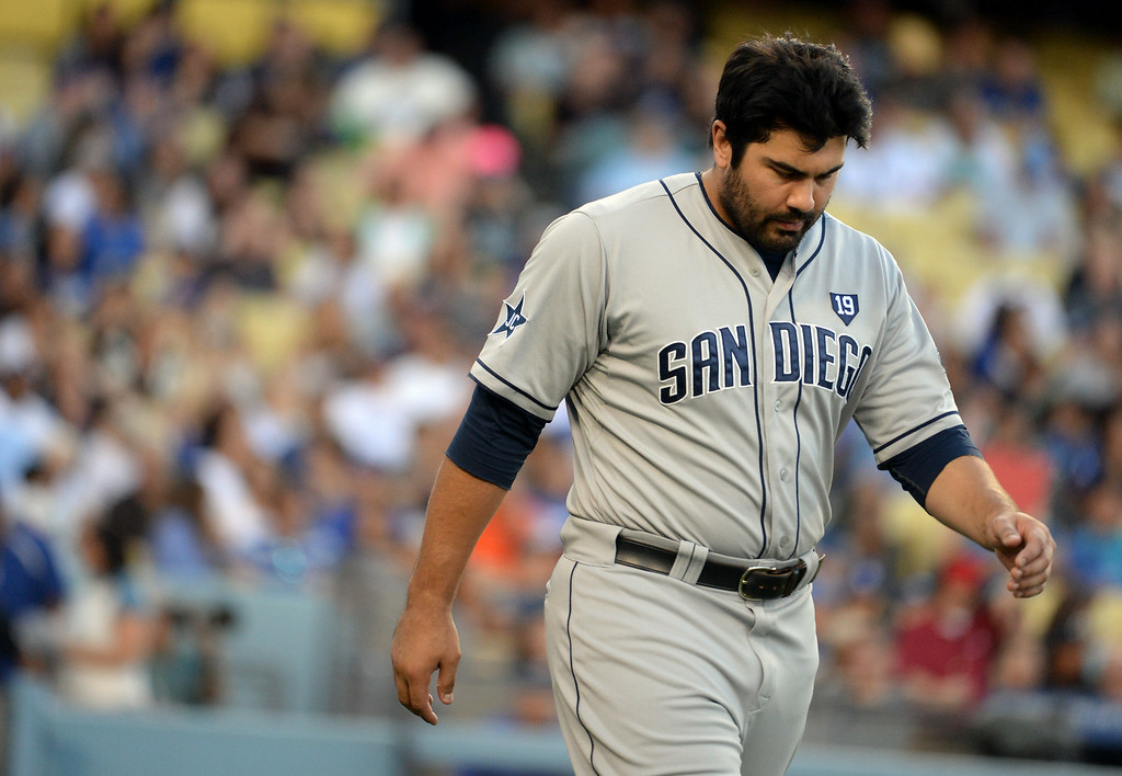 Description of . San Diego Padres' Carlos Quentin walks back to his position after striking out looking in the first inning of a Major league baseball game on Saturday, July 12, 2014 in Los Angeles.   (Keith Birmingham/Pasadena Star-News)