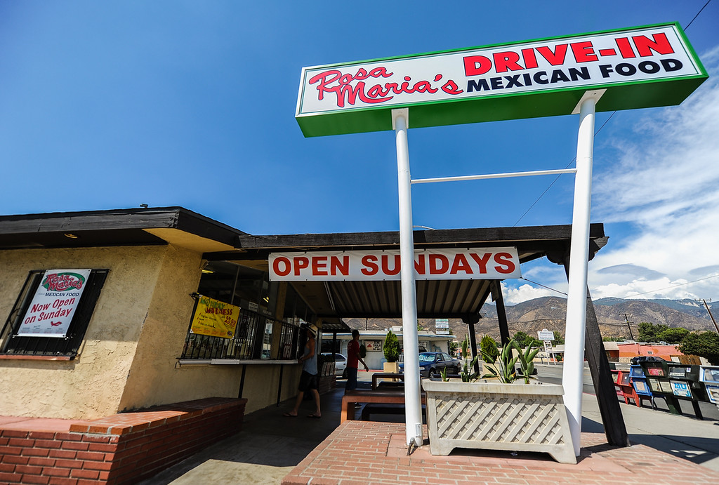 Description of . Customers visit a local food hotspot at Rosa Maria's in San Bernardino Wednesday, Sept. 4, 2013. Rosa Maria's is known for its exclusive Garbage Burrito menu item. (Photo by Rachel Luna / San Bernardino Sun)