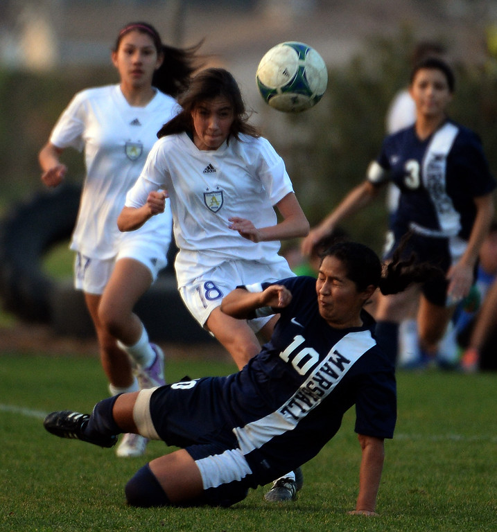 Description of . Marshall's Roxana Hernandez (10) fights for the ball with Bishop Amat's Ashley Rushlow (18) in the first half of a prep soccer match at Bishop Amat High School in La Puente, Calif., on Thursday, Jan. 9, 2014.Amat won 3-0. (Keith Birmingham Pasadena Star-News)