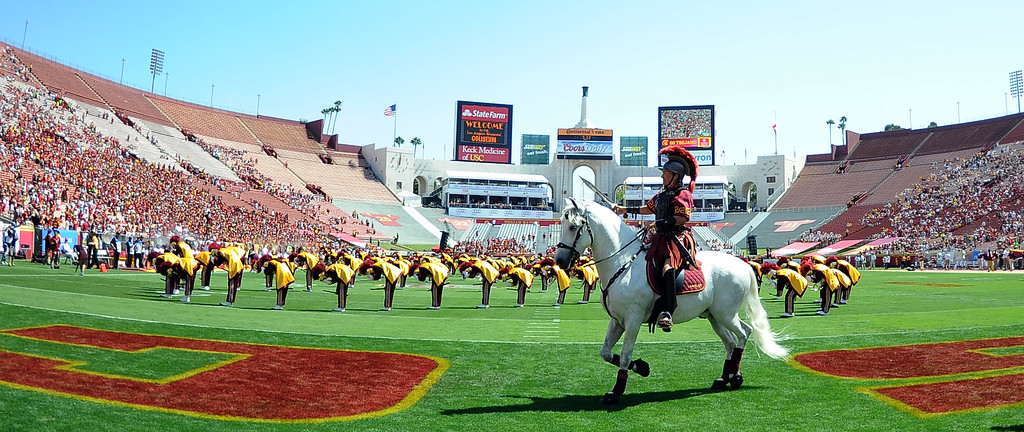 Description of . The Southern California Trojan Marching band performs prior to a NCAA college football game against Boston College in the Los Angeles Memorial Coliseum in Los Angeles, on Saturday, Sept. 14, 2013.