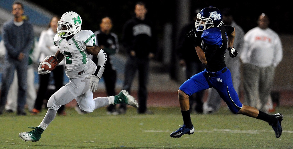 Description of . Monrovia's Kurt Scoby (2) runs for a 82 yard touchdown against San Marino in the first half of a prep football game at Monrovia High School in Monrovia, Calif., on Friday, Nov. 8, 2013. 