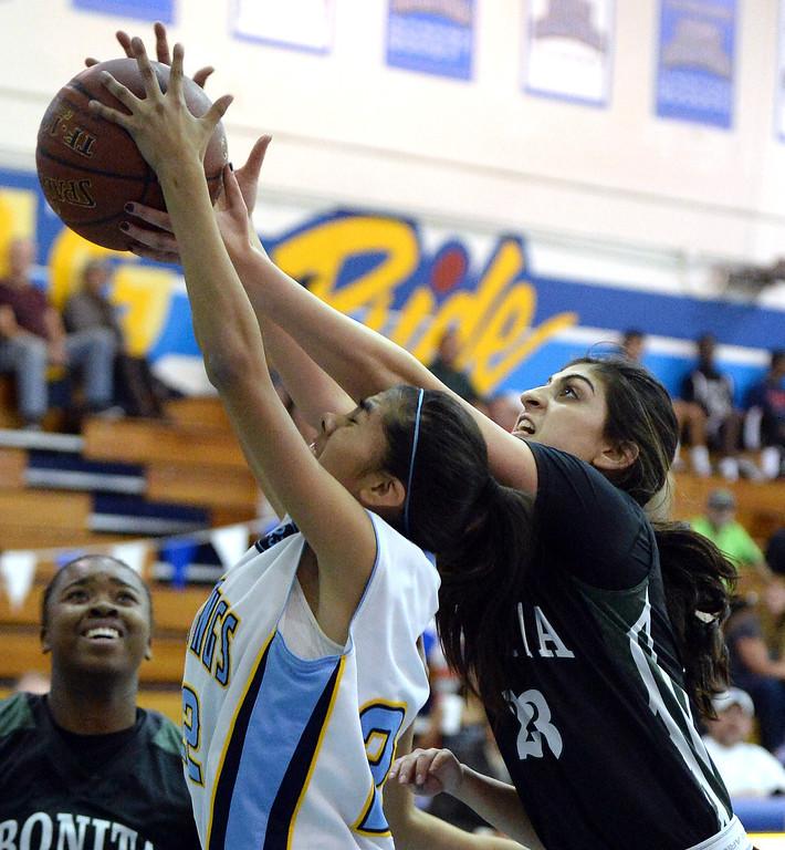 Description of . Walnut's Paulina Ochoa (22) fights for the rebound with Bonita's Sam Naanouh (23) in the first half of a prep basketball game at Walnut High School in Walnut, Calif., on Wednesday, Jan. 15, 2014. Bonita won 60-50. (Keith Birmingham Pasadena Star-News)
