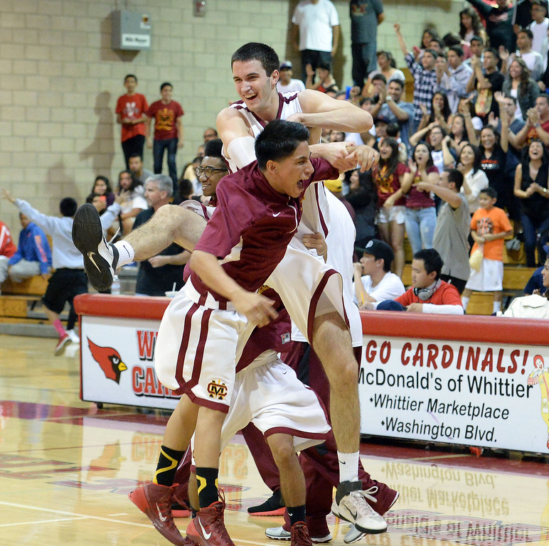 Description of . Cantwell's Balsa Dragovic, center/top, reacts after defeating Village Christian 51-48 during a State Division 4 CIF Prep Playoff Basketball game at Whittier High School in Whittier, Calif., on Saturday, March 15, 2014.  (Keith Birmingham Pasadena Star-News)