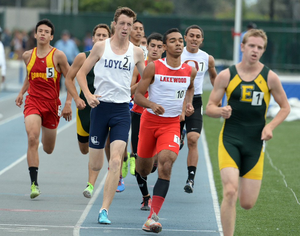 Description of . Loyola's John Davis competes in the division 1 800 meters race during the CIF Southern Section track and final Championships at Cerritos College in Norwalk, Calif., Saturday, May 24, 2014. 