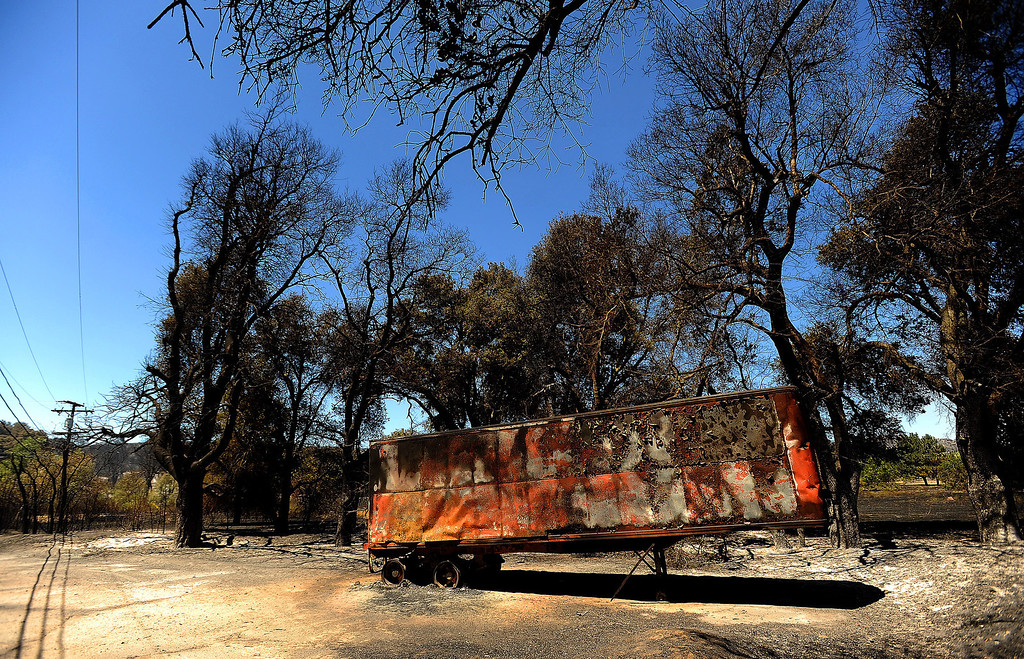 Description of . A view of a trailer that was burned one along Twin Pines Road in the mountains south of Banning August 8, 2013.   GABRIEL LUIS ACOSTA/STAFF PHOTOGRAPHER.
