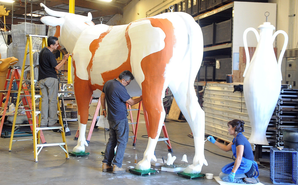 Description of . Workers paint one of many different floats for the upcoming 2014 Rose Parade at Fiesta Parade Floats in Irwindale, Calif. on Saturday, Sept. 7, 2013.   (Photo by Keith Birmingham/Pasadena Star-News)