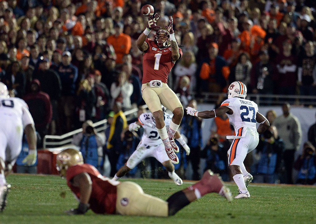 Description of . Florida State wide receiver Kelvin Benjamin (1) catches a pass for a 21 yard first down pass play against Auburn in the fourth quarter of the BCS National Championship game at the Rose Bowl in Pasadena, Calif., on Monday, Jan. 6, 2014. Florida State won 34-31.