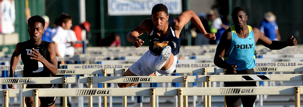 Description of . Millikan's Misana Viltz, center, along with Upland's Joseph Anderson, left, and Long Beach Poly's Juan Ward competes in the 110 meter hurdles during the CIF-SS Masters Track and Field meet at Falcon Field on the campus of Cerritos College in Norwalk, Calif., on Friday, May 30, 2014.   (Keith Birmingham/Pasadena Star-News)