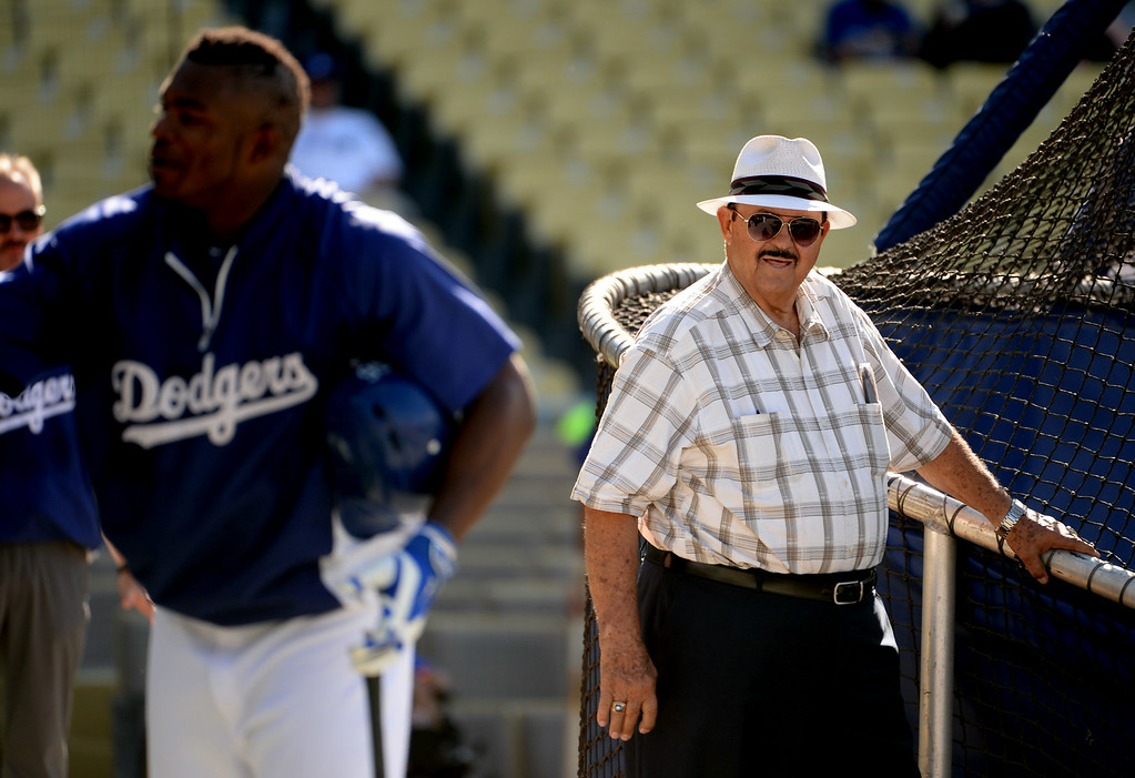 Description of . Former Los Angeles Dodgers scout Mike Brito, right, looks on during batting practice prior to a Major league baseball game against the San Diego Padres on Saturday, July 12, 2014 in Los Angeles.   (Keith Birmingham/Pasadena Star-News)