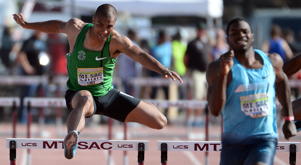Description of . Ashton Eaton, left, competes in the 400 meter hurdles Invitational elite during the Mt. SAC Relays in Hilmer Lodge Stadium on the campus of Mt. San Antonio College in Walnut, Calif., on Saturday, April 19, 2014. 