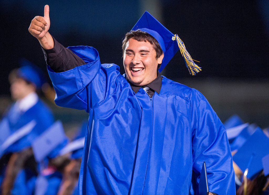 Description of . Matthew Avila gives the thumbs up after receiving his diploma during California High graduation at their Whittier campus stadium June 13, 2013.   (SGVN staff photo by Leo Jarzomb)