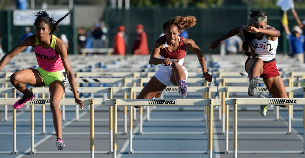 Description of . Alemany's Skylin Harbin, center along with Pasadena Poly's Ebony Crear,left, and Long beach Wilson's Elijah McDonald competes in the 100 meter hurdles during the CIF-SS Masters Track and Field meet at Falcon Field on the campus of Cerritos College in Norwalk, Calif., on Friday, May 30, 2014.   (Keith Birmingham/Pasadena Star-News)