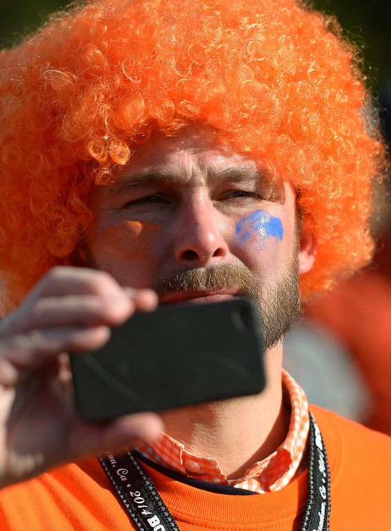 Description of . Auburn alumn Brandon Ashby, of New Jersey, takes a picture at an alumni party before the BCS game at the Rose Bowl, Monday, January 6, 2014. (Photo by Michael Owen Baker/L.A. Daily News)