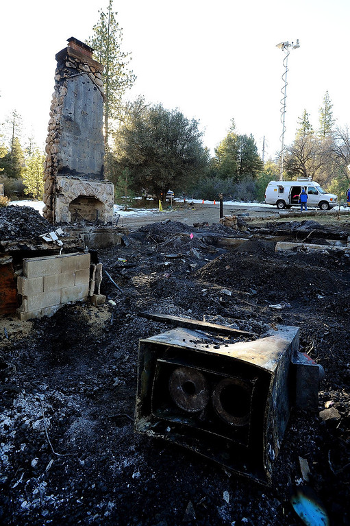 Description of . A burned out cabin is all that remains of fugitive Christopher Dorner's last stand as seen  in Seven Oaks February 15, 2013.  (Staff photo by Gabriel Luis Acosta/The Sun)