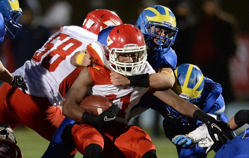 Description of . San Dimas defense tackles Paraclete's Melquise Stovall for a loss of yards in the first half of a CIF-SS Mid-Valley Division championship football game at San Dimas High School in San Dimas, Calif., on Friday, Dec. 6, 2013.   (Keith Birmingham Pasadena Star-News)