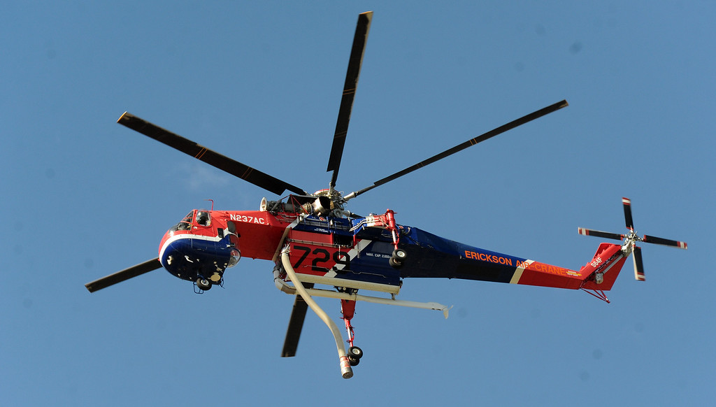 Description of . A Erickson Air-Crane flies after making a drop as Los Angeles County Firefirghters with aid of water dropping helicopters battle a five acre brush fire in the San Gabriel Mountains above Azusa just above the former Shooting range on Tuesday, Aug. 27, 2013 in Azusa, Calif.   (Keith Birmingham/Pasadena Star-News)