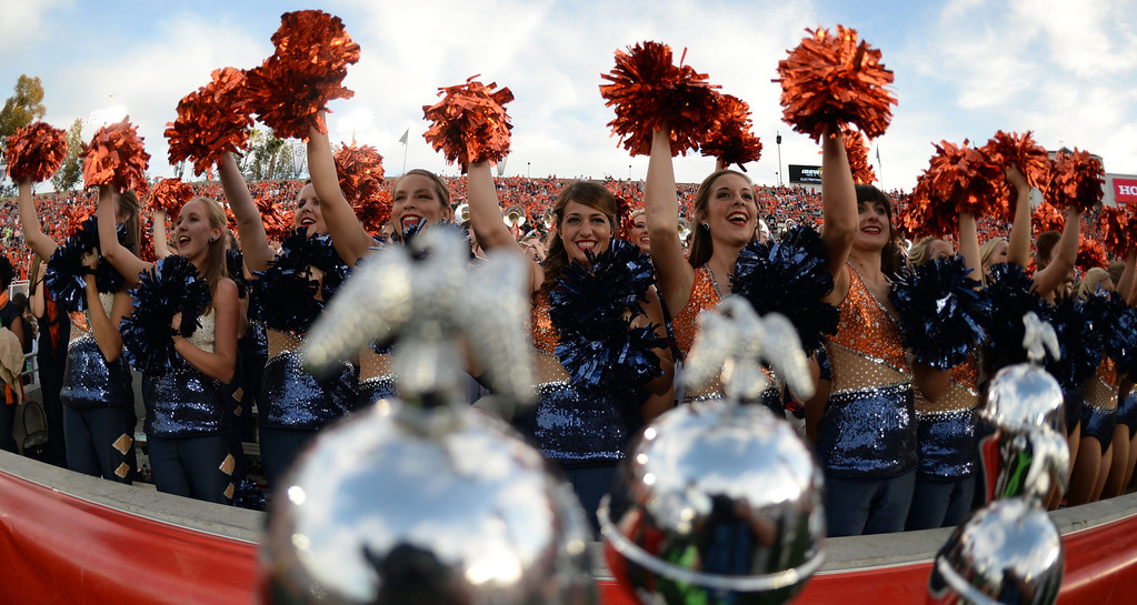 Description of . Auburn cheerleaders prior to the BCS National Championship game against Florida State at the Rose Bowl in Pasadena, Calif., on Monday, Jan. 6, 2014.   (Keith Birmingham Pasadena Star-News)