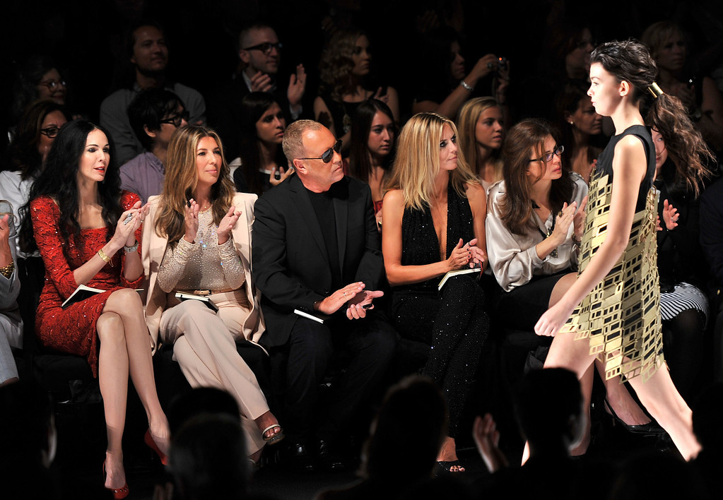 Description of . (L-R) Project Runway judges L'Wren Scott, Nina Garcia, Michael Kors, Heidi Klum and Desiree Gruber attend the Project Runway Spring 2012 fashion show during Mercedes-Benz Fashion Week at The Theater at Lincoln Center on September 9, 2011 in New York City.  (Photo by Stephen Lovekin/Getty Images for Mercedes-Benz Fashion Week)