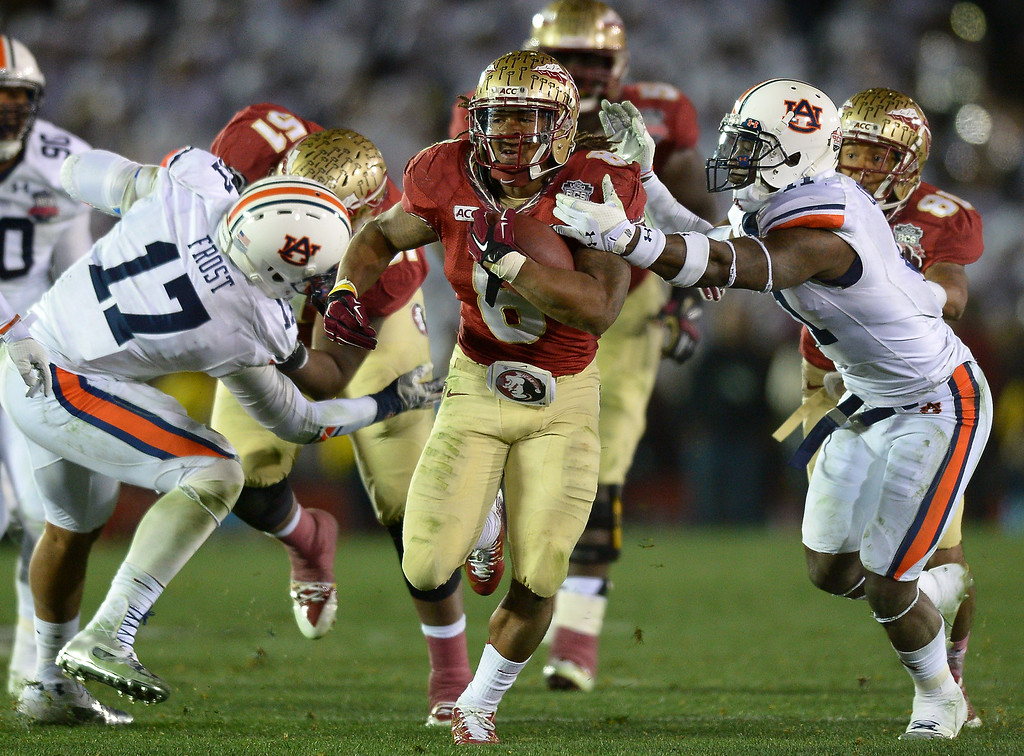 Description of . Florida State RB Devonta Freeman breaks a long run against Auburn in the second half of the BCS national championship game at the Rose Bowl, Monday, January 6, 2014. (Photo by Michael Owen Baker/L.A. Daily News)