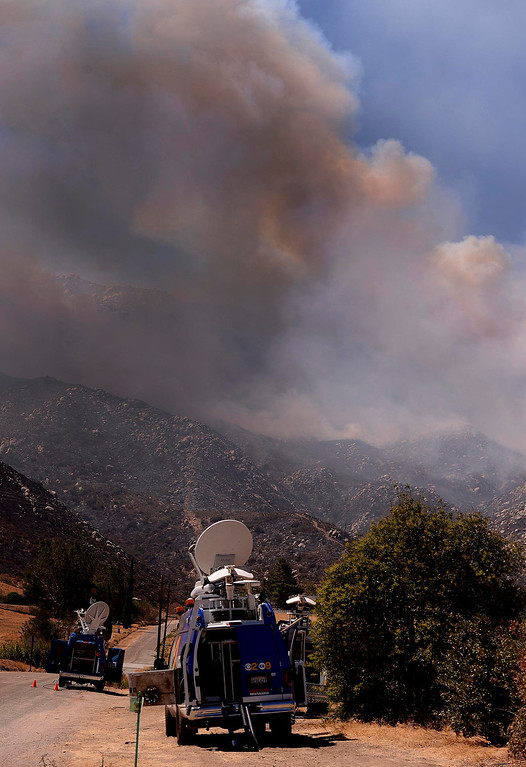 Description of . Television crews cover the Silver Fire as it burns in the mountains south of Banning August 8, 2013.   GABRIEL LUIS ACOSTA/STAFF PHOTOGRAPHER.