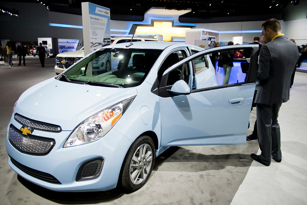 Description of . The 2014 Chevy Spark EV at Los Angeles Auto Show on Wednesday, Nov. 20, 2013, in Los Angeles. (Photo by Watchara Phomicinda/San Gabriel Valley Tribune)