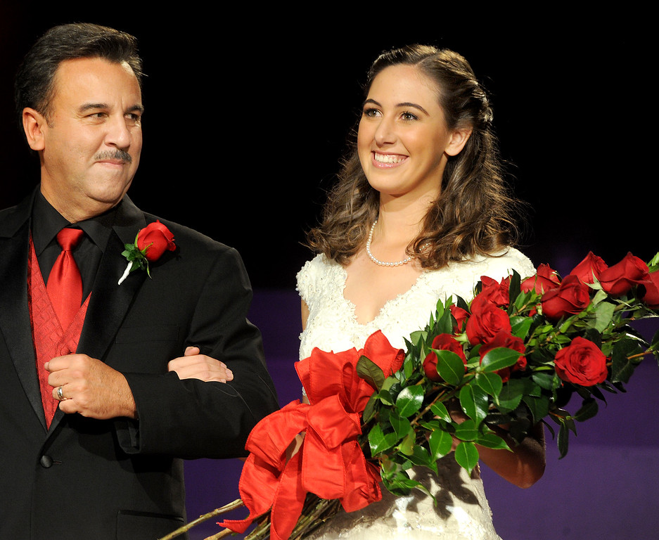 Description of . Ana Marie Acosta, 17, father Dr. John H. Acosta walking with his daughter, Ana Marie Acosta who was name Tournament of Roses Announcement and Coronation of the 96th Rose Queen and Presentation of the 2014 Royal Court held at First Church of the Nazarene of PasadenaThursday, October 24, 2013. (Photo by Walt Mancini/Pasadena Star-News)