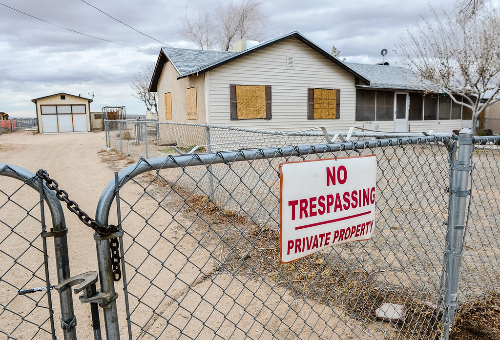 Description of . Evidence of Hinkley's desolation appears in a vacant home in Hinkley, Calif. on Thursday, March 7, 2013. PG&E has extended buyout offers to 366 Hinkley homeowners since 2010, and boarded-up homes is a common sight in the town. (Rachel Luna / San Bernardino Sun)
