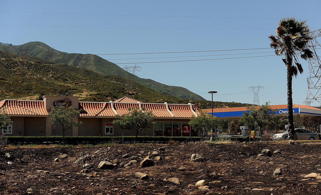 Description of . A view of a strip mall that burned in Mondays fire along the I-15 freeway near Sierra Avenue exit in North Fontana May 14, 2013.  GABRIEL LUIS ACOSTA/STAFF PHOTOGRAPHER.