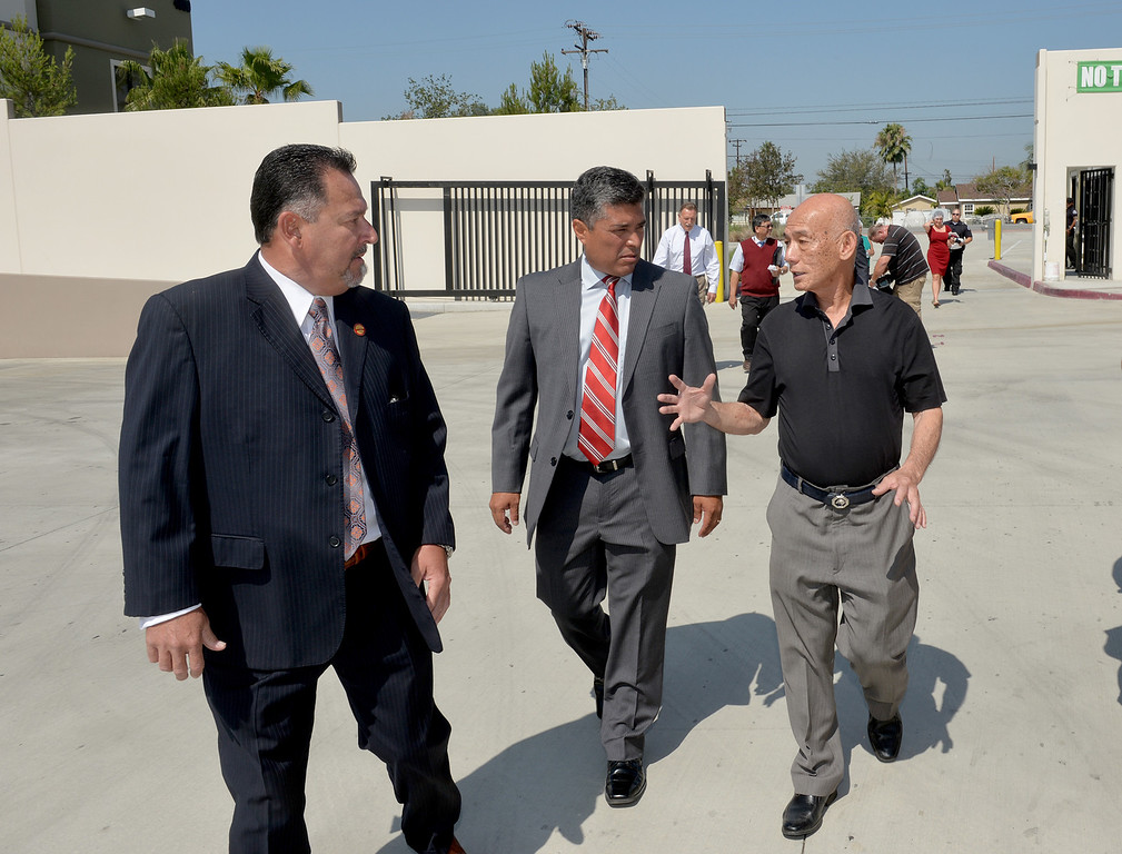 Description of . Irwindale Mayor Mark Breceda, left, and City Councilman Julian Miranda , center, tour the Huy Fong Foods plant with CEO David Tran on Tuesday May 27, 2014. A team from Governor Jerry Brown's Office of Business and Economic Development joins the tour of the 650,000 square-foot facility that the council voted has created a public nuisance. (Photo by Keith Durflinger/Whittier Daily News)