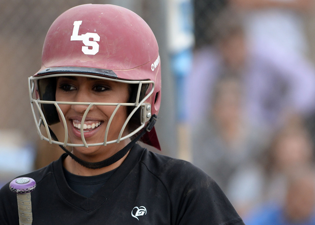 Description of . La Serna's Taylor Becerra smiles after scoring on a two RBI single by Danielle Garcielita (not pictured) in the fourth inning of a prep playoff softball game at Bishop Amat High School in La Puente, Calif., on Thursday, May 22, 2014. La Serna won 6-0.   (Keith Birmingham/Pasadena Star-News)