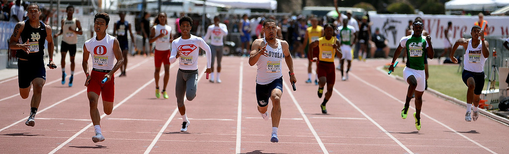 Description of . Loyola's Mekai Sheffle, center, competes 4x100 Invitational during the Mt. SAC Relays in Hilmer Lodge Stadium on the campus of Mt. San Antonio College in Walnut, Calif., on Saturday, April 19, 2014. 