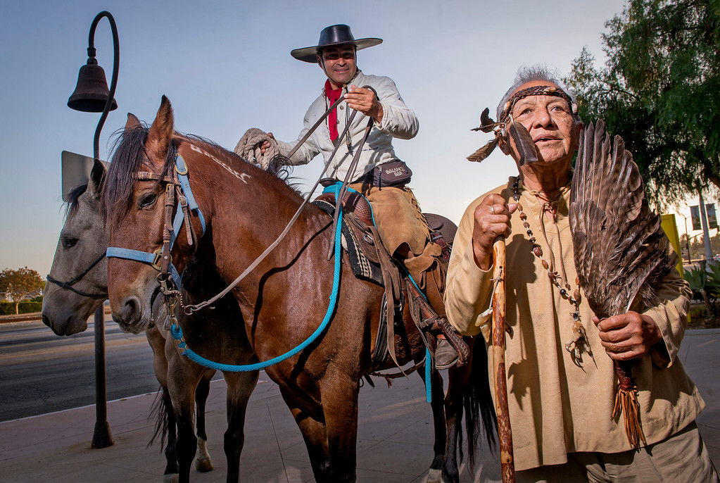 Description of . Ernie Salas, chief of the Gabrieleño Band of Mission Indians/Kizh Nation,  greets the seven horseback enthusiasts at Mission San Gabriel as part of The California Mission Ride October 8, 2013.   (Staff photo by Leo Jarzomb/Pasadena Star-News)